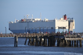 Car Carrier Passing the Village Pier