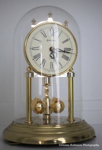 Gold Tone Clock With Weights and Glass Dome